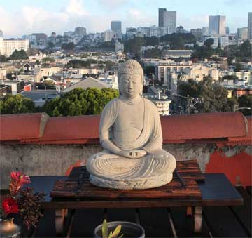 Buddha on Roof of SFZC; city in background